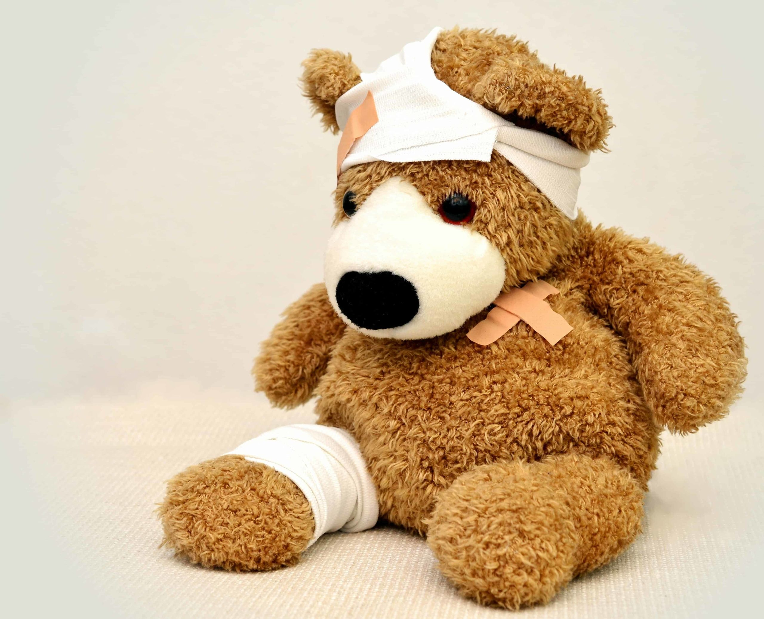 Brown and White Bear Plush Toy with bandages and plasters